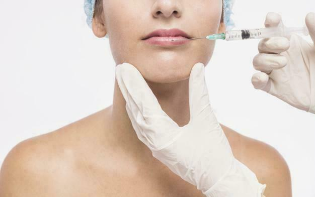 doctor injecting woman lips 23 2147929573