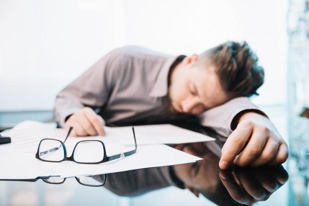 employee sleeping office 23 2147717288