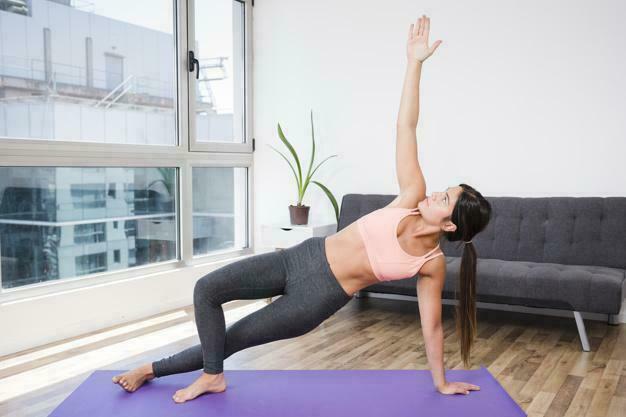 woman doing yoga home 23 2148108689